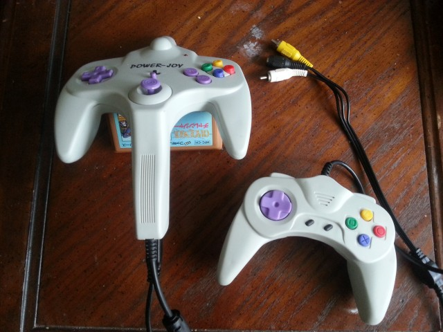 Wow, it's been a long time since I've had an actual image on this blog, right? Anyway, the top of the N64-ish controller actually has a pointy bit that functions as the Zapper. The trigger is where the N64's Z button would be. It doesn't work well.